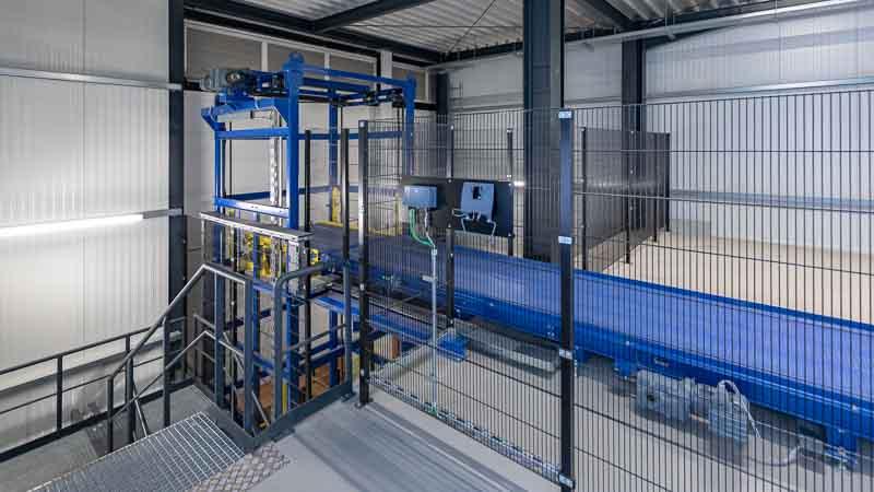 Fördertechnik Integration die die Produktion - Vertikalförderer als Brückenlösung